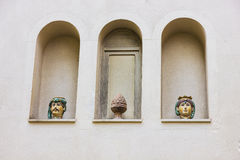 Pots on a facade, in Taormina, Italy. Two pots on a facade, in Taormina, Italy Stock Photography