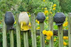 Pots on a farm fence in the countryside Stock Photography