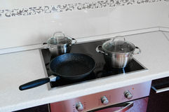 Pots and a frying pan Stock Images