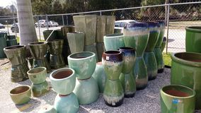 Pots galore. Gardening pots of various colours shapes and sizes stock image