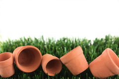 Pots and grass with copy space. Mini clay pots on grass with copy space royalty free stock photos