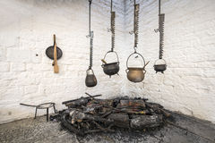 Pots hanging over a fire Stock Images