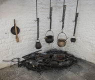 Pots hanging over a fire Royalty Free Stock Photo