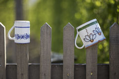 Pots hanging on a wooden fence Royalty Free Stock Images