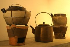 Pots, kettle and charcoal stove Royalty Free Stock Photo