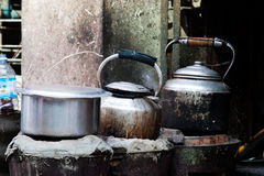 Pots and kettles on the stove Royalty Free Stock Images