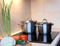 Pots in kitchen Stock Images