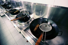Pots in Kitchen. Steel and wooden Pots in Kitchen of a chinese resturant Stock Image