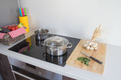 Pots on kitchen stove. And ingredients for cooking Royalty Free Stock Images