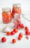 Pots of marinated tomatoes Royalty Free Stock Photos