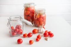 Pots of marinated tomatoes Stock Photo