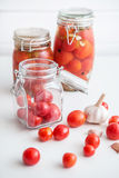 Pots of marinated tomatoes Stock Images