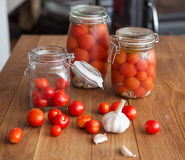 Pots of marinated tomatoes Stock Image