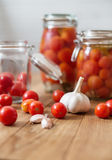 Pots of marinated tomatoes Royalty Free Stock Images