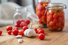 Pots of marinated tomatoes Royalty Free Stock Photography