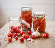 Pots of marinated tomatoes Stock Photography