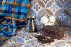 Pots, marshmallows, coffee beans, box. On a table with an Asian pattern Royalty Free Stock Photo