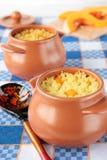 Pots of millet porridge with pumpkin stock image