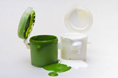 Pots with paint. Pots with green and white paint Royalty Free Stock Photo