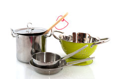 Pots and pans. Kitchen equipment with pots and pans isolated over white royalty free stock images