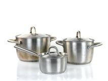 Pots and Pans. Isolated against a white background royalty free stock photography