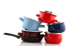 Pots and pans. Big stack with pots and pans isolated over white stock photo