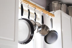 Pots and Pans. Hanging on a rack in a kitchen Royalty Free Stock Photos
