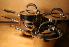 Pots and Pans. Sitting on a wooden tables Royalty Free Stock Images