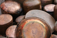 Pots and pans. Old copper pots and pans royalty free stock images