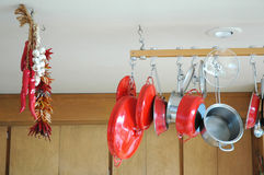 Pots and Pans. Hanging pots and pans in a kitchen Stock Photography