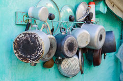 Pots, pans, lids and pots on the wall Royalty Free Stock Photography