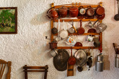 Pots, pans and utensils in an old village house kitchen Royalty Free Stock Photography
