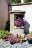 Pots with red geranium and petunia flowers for street decoration in Spain Stock Photography