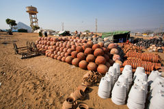 Pots for sale in desert village of indian craftsmen Royalty Free Stock Photography