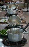 Pots sales après cuisson d'un repas Photographie stock libre de droits