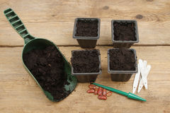 Pots and seeds on a potting bench Stock Image