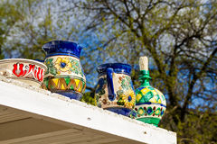 Pots on shelf outdoor Royalty Free Stock Images