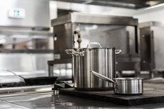 Pots standing on hotplate Royalty Free Stock Photos