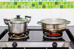 Pots and steaming pot. On the stove stock images