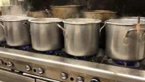 Pots on a Stove in an Industrial Kitchen. 9346 Pots boiling pierogies in an industrial kitchen stock video footage