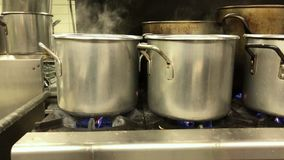 Pots on a Stove in an Industrial Kitchen. 9347 Pots boiling pierogies in an industrial kitchen stock video