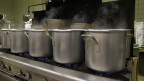 Pots on a Stove in an Industrial Kitchen. 10167 Pots boiling pierogies in an industrial kitchen or cafeteria stock video footage