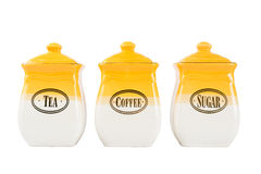 Pots of tea, coffee and sugar, yellow-white color on a white bac Stock Photos