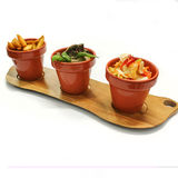 Pots with vegetable mix. Stock Photos