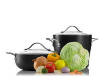 Pots and vegetables Royalty Free Stock Images