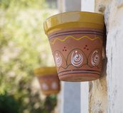 Pots on the wall of a house. Decorated pots on the wall of a house in Brossac France Stock Photos