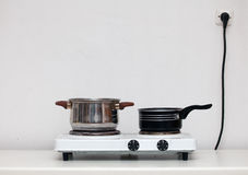Pots on white electric cooker (stove) Royalty Free Stock Photos