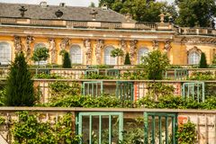 Sanssouci palace. AT POTSDAM - BRANDENBURG - GERMANY - ON 08/29/2013 - Sanssouci palace, surrounded by its wonderful park in summer stock images