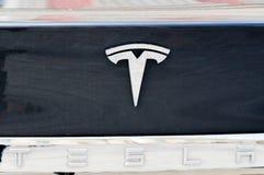 Tesla Motors logo on a black car. stock photos