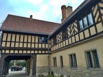 Potsdam / Germany - March 24 2018: Side part of the palace Cecilienhof. A group of tourist is listening to a guide in the distance stock photos